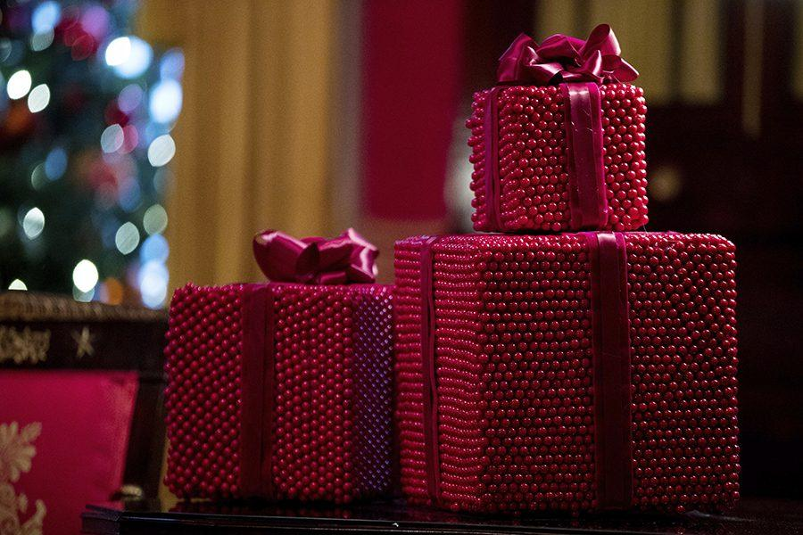 Decorative presents are on display in the Red Room at the White House during a preview of the 2016 holiday decor, Tuesday, Nov. 29, 2016, in Washington. (AP Photo/Andrew Harnik)