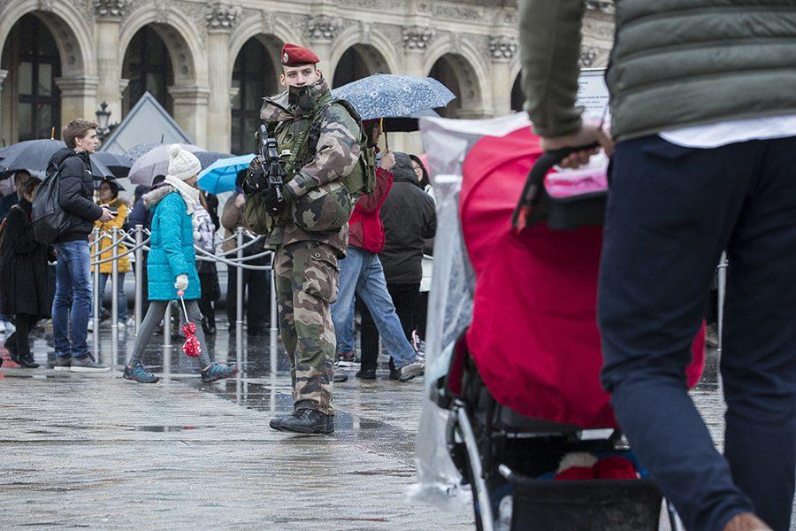 A French soldier patrols in the courtyard of the Louvre museum in Paris, Saturday, Feb. 4, 2017.  The Louvre in Paris reopened to the public Saturday morning, less than 24-hours after a machete-wielding assailant shouting