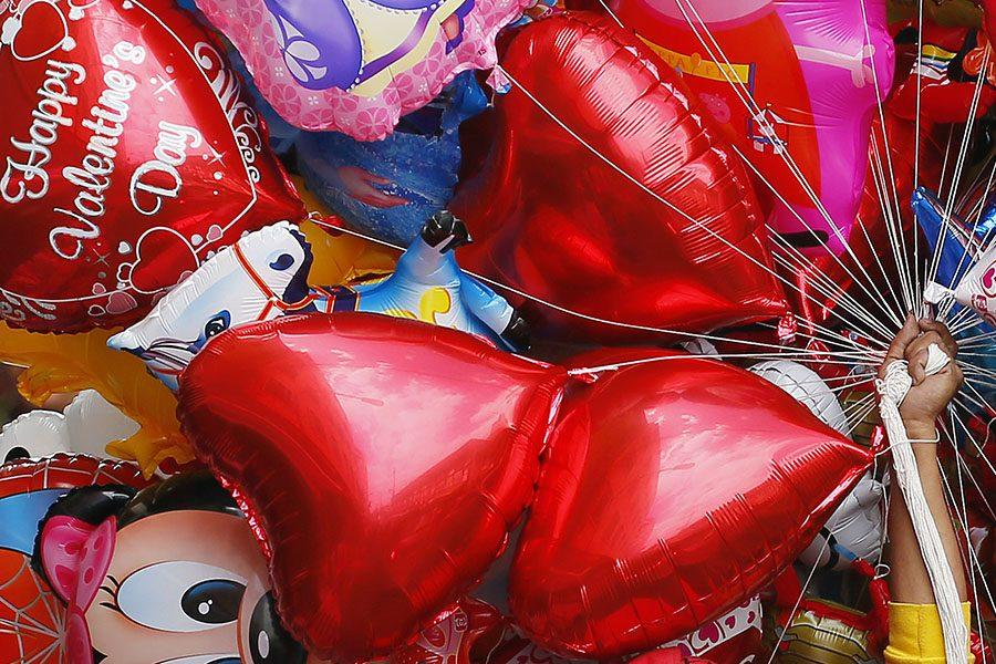 A vendor sells balloons on Valentine's Day, Tuesday, Feb.14, 2017, in Manila, Philippines. Valentine's Day, associated with love and romance, is expressed with flowers, chocolates, balloons and dinner dates. (AP Photo/Bullit Marquez)
