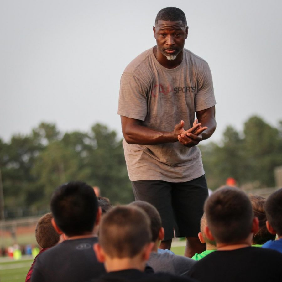 New Orleans Saints Defensive Backs Coach Aaron Glenn speaks to youth football players at Klein Oak HS - Tuesday, July 17, 2018