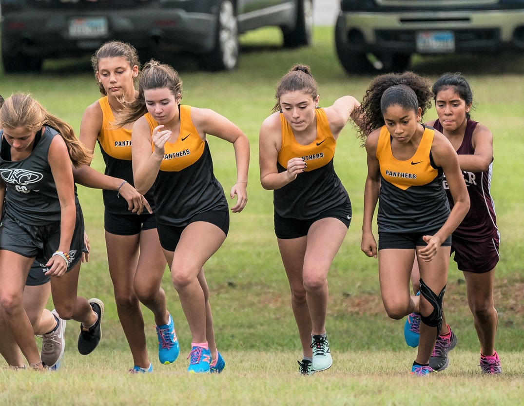 The Oak JV Cross Country Team gets off the line at the start of the Heat Wave Meet in Tomball, August 18, 2018.
