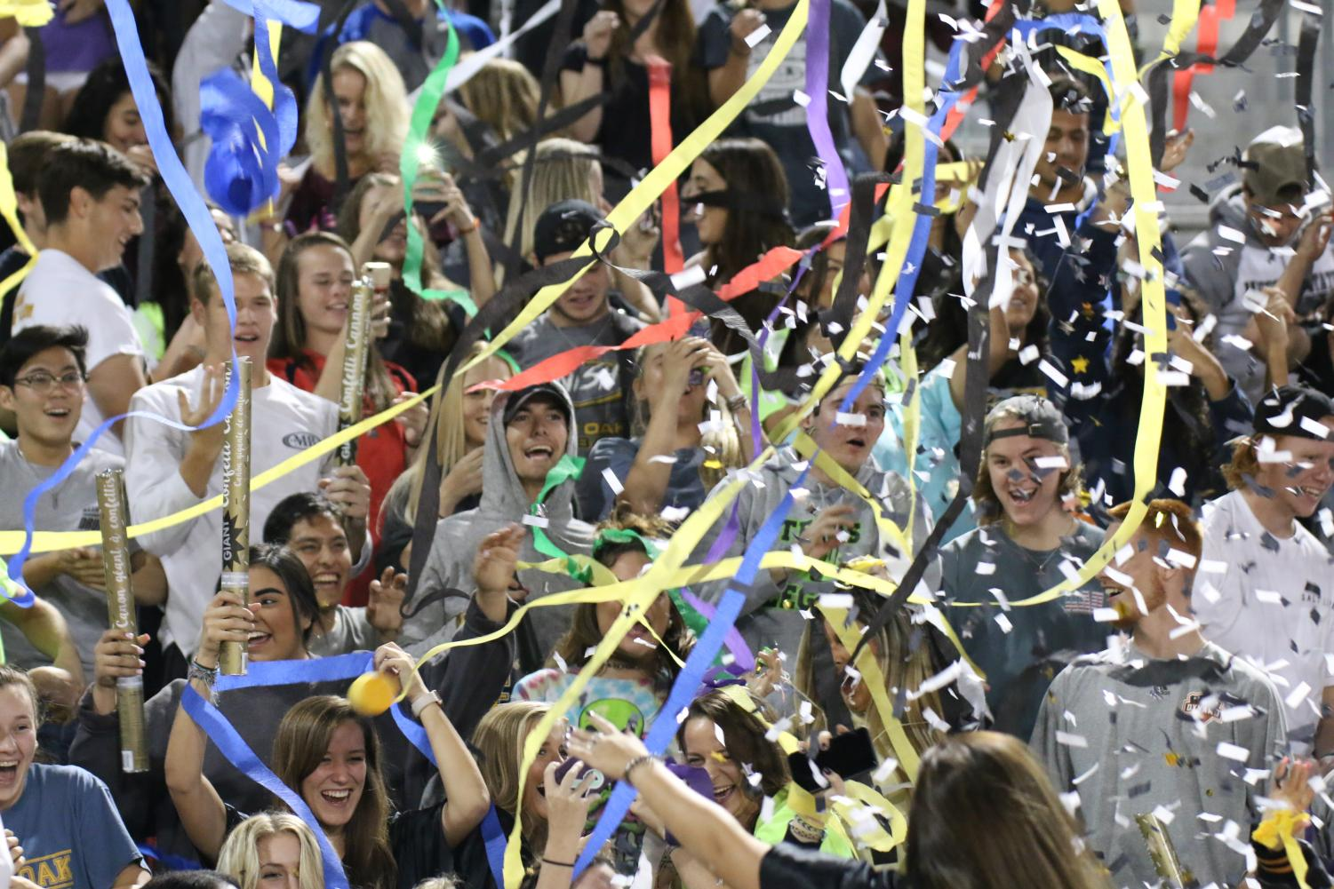 Celebrating during 3rd quarter with the drum line, the new stand leader organization ignites excitement in the student body.