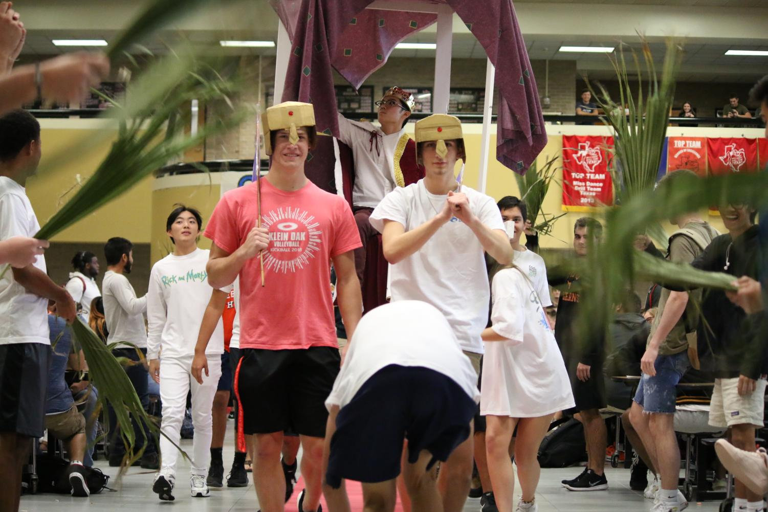 As the 'red carpet' is rolled out, senior Jon Shin makes his grand entrance during D lunch to his 'queen'.