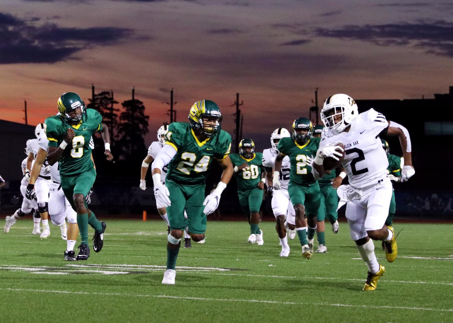Junior running back Kendal Taylor sprints past the Klein Forest defense for a first down.