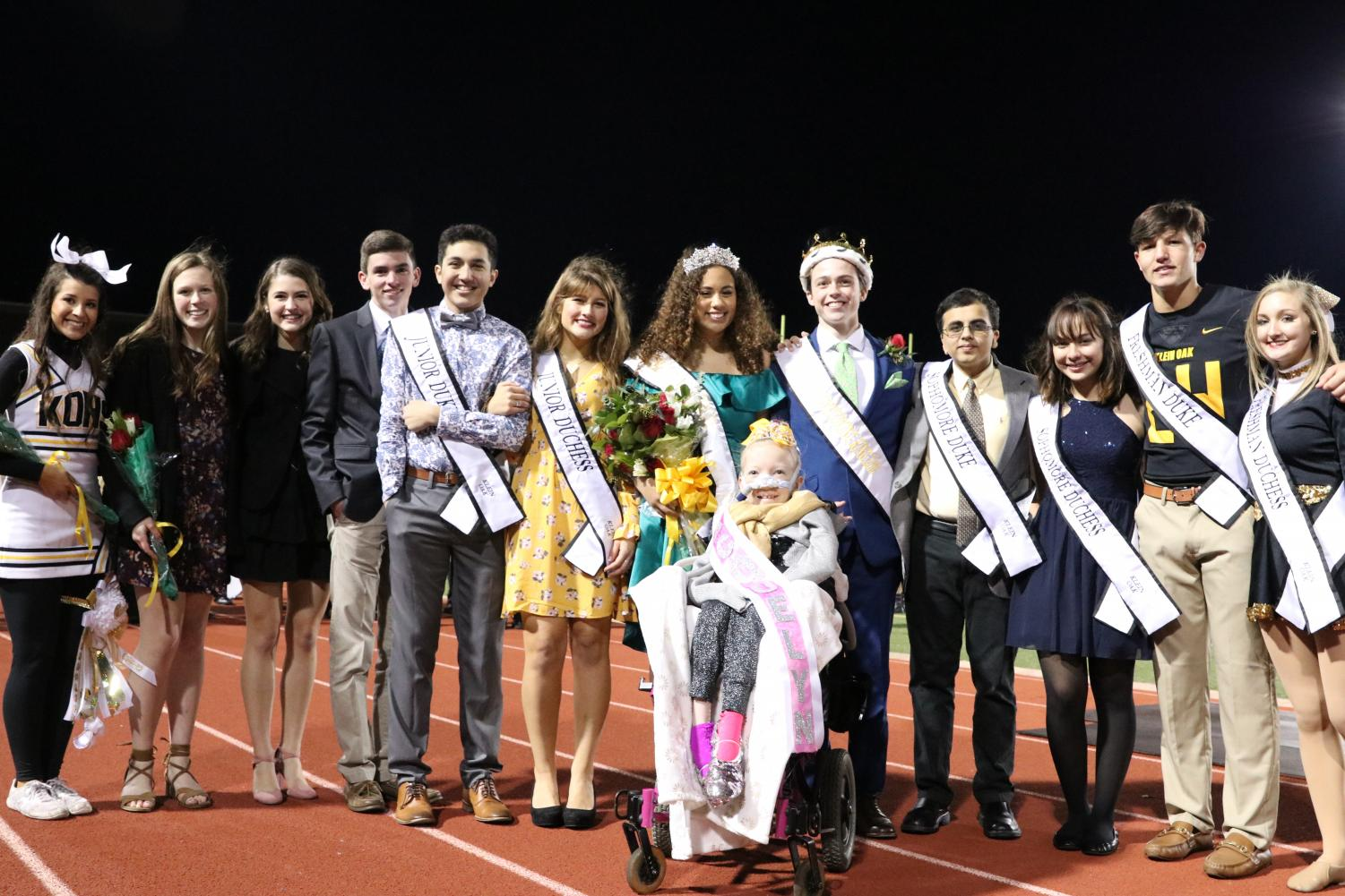 The 2018 Homecoming Court surrounds Jacqueline Dyer after she is crowned as an honorary Homecoming Princess. Dyer's organization namesake, Just for J, was the recipient of $15,000 raised by the Klein Oak community.