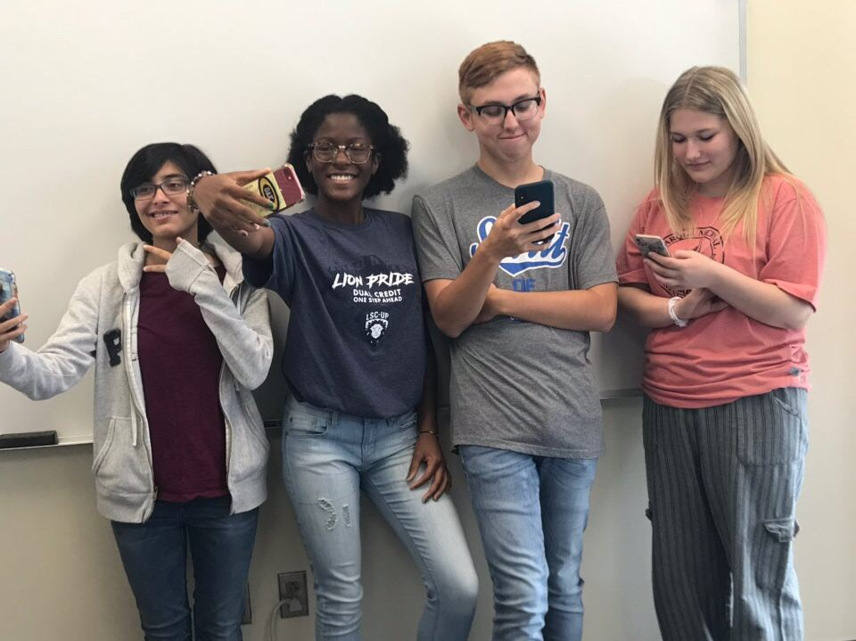 Student administrators Zainab Ansari, Maddison Westbrooks, Noah Hayes, and Jenna Bluth pose for a selfie during a meeting.