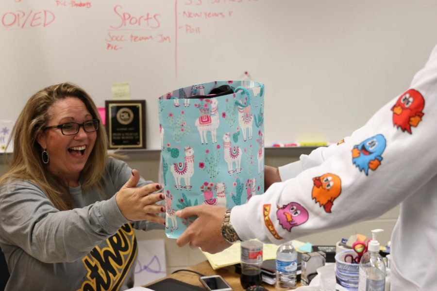 Student delivers gift, surprising Joanie Gill.