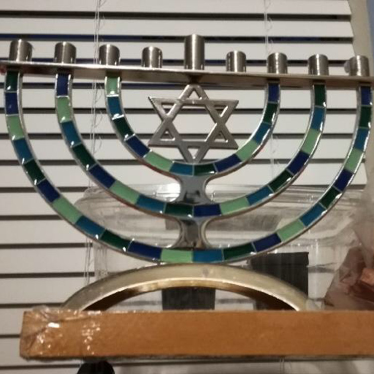 A+centerpiece+of+the+celebration+Hanukkah+is+the+menorah.+The+ancient+lamp+holds+nine+candles.+The+lighting+of+eight+candles+symbolizes+the+number+of+days+that+the+Jewish+temple+blazed%2C+with+the+ninth+used+for+lighting+the+others.+This+is+the+menorah+used+in+the+Greenwald+household+and+apart+of+their+religious+traditions.