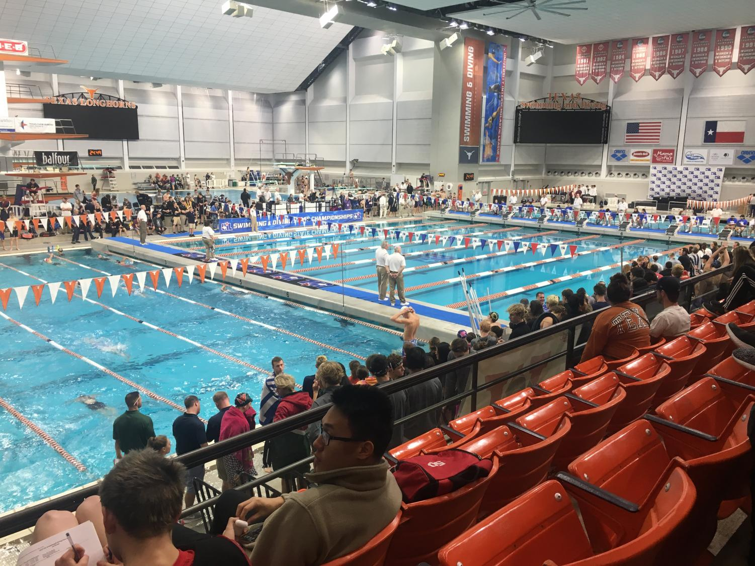 All swimmers warm up in the Lee & Joe Jamail Aquatic Center before the races start. Six Oak athletes competed in the weekend-long State meet in mid-February.