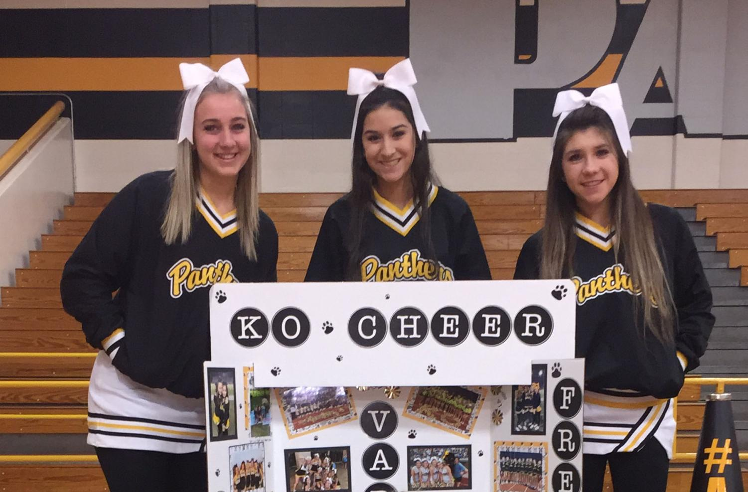 Drumming up interest as the 8th graders from Hildebrandt, Hofius, and Krimmel visit the campus, juniors Madi Gorton, Jazmine Ceniceros and Clara Ramos gather around a cheer tri-fold which features highlights from the season of all three squads.
