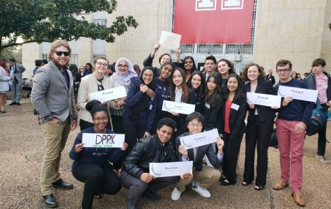 The Model UN club poses with their country placards after participating in the HAMUN conference at the University of Houston.