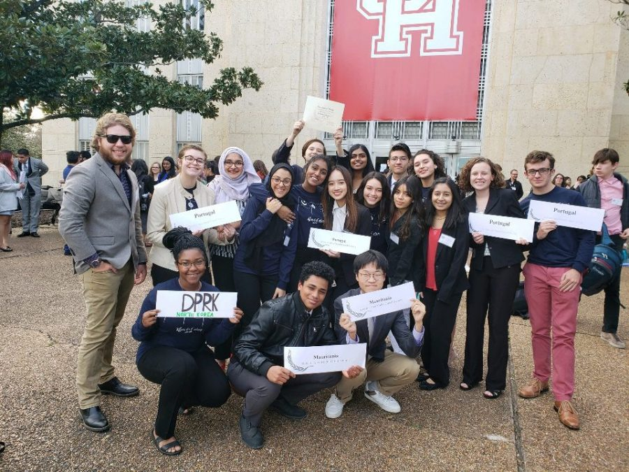 The+Model+UN+club+poses+with+their+country+placards+after+participating+in+the+HAMUN+conference+at+the+University+of+Houston.