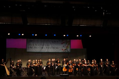 Oak Chamber Orchestra stands for a photo after performing on stage in the Kiva Auditorium at the Albuquerque Convention Center on March 8.