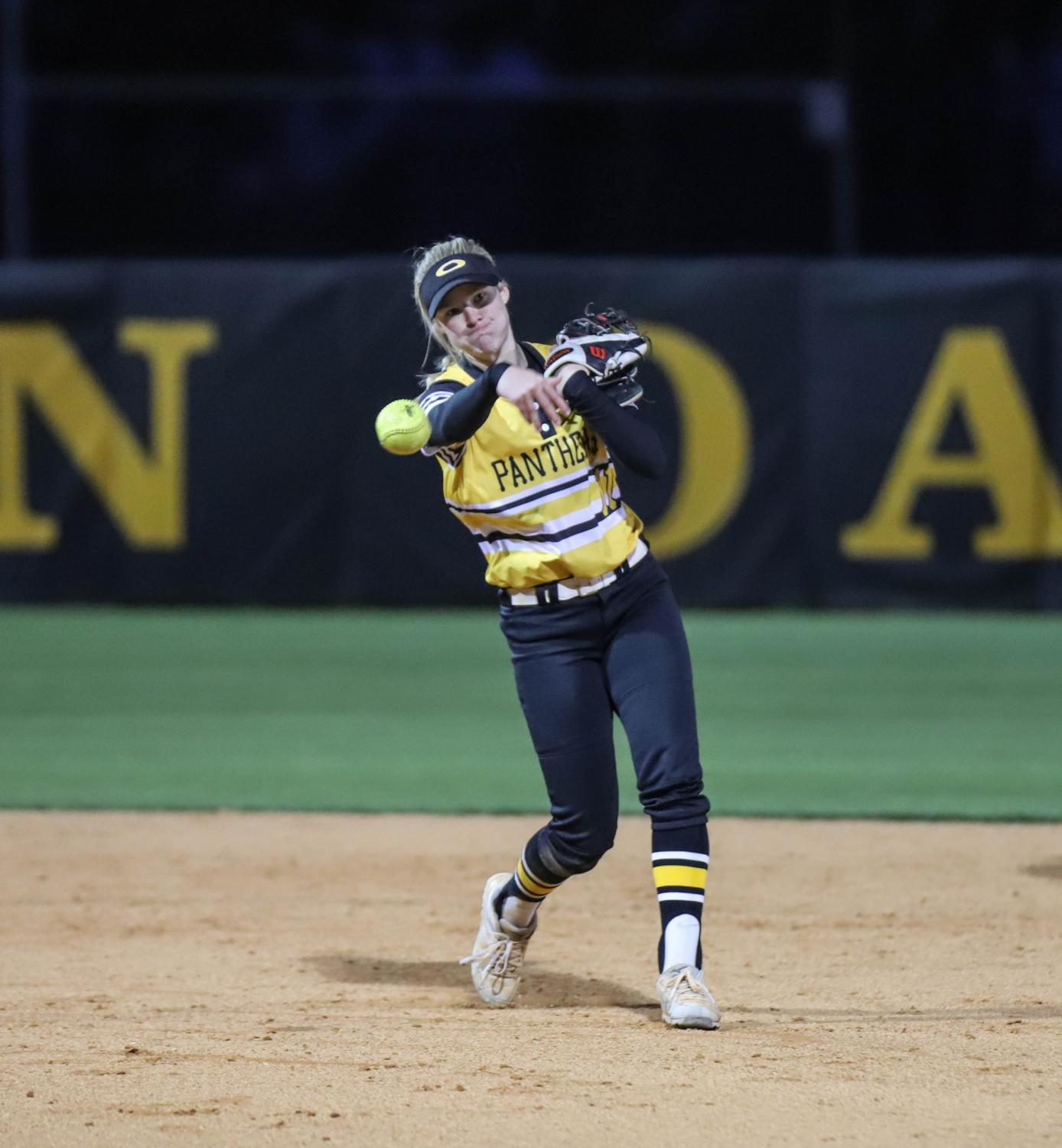 Shortstop Paige Hulsey makes a throw to first base to beat the runner. Hulsey will be attending the University of Houston to play softball.
