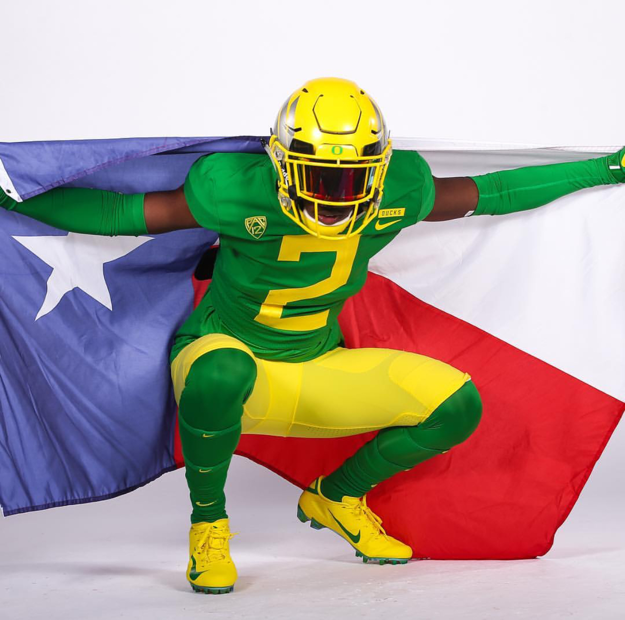 While on an unofficial visit to the University of Oregon, junior Dwight McGlothern poses in the green and yellow  threads. Head Coaches around the nation utilize this tactic to lure in potential recruits across the country.