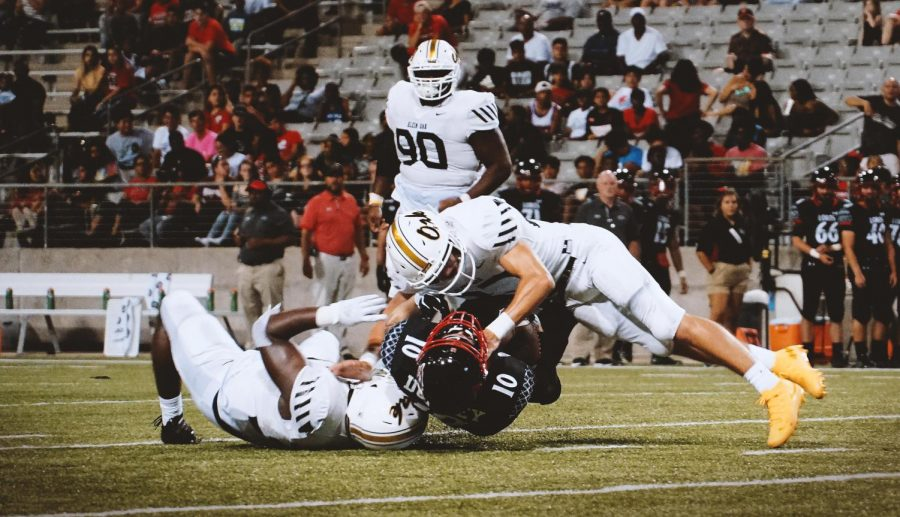 Junior Clay Habermacher and senior Dreydon Hall make a big hit on the Lobos wide receiver. The Panther defense dominated all night by not letting Langham find the endzone once.