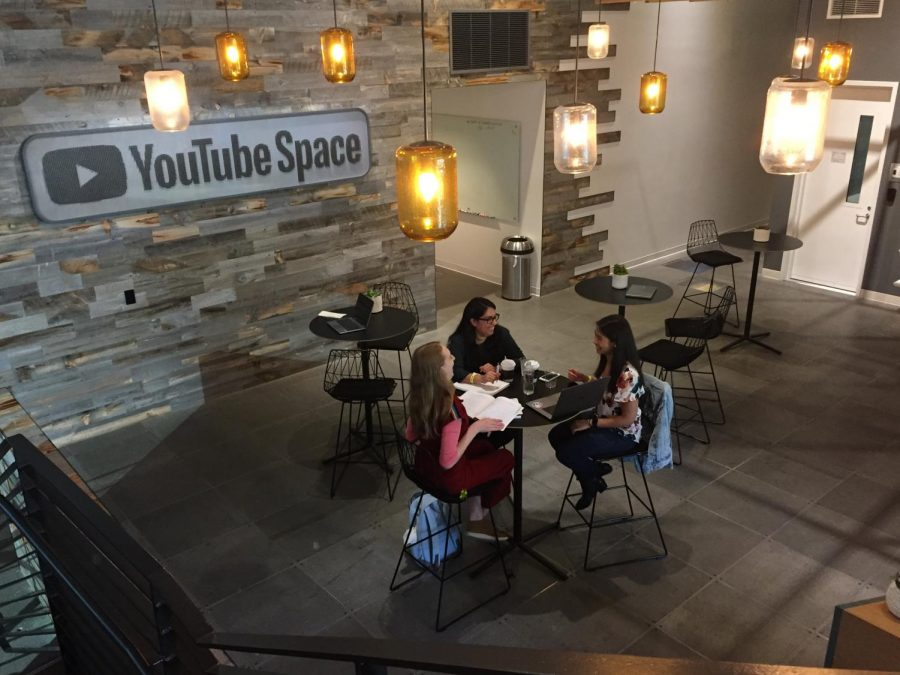 At the YouTube space in Los Angeles, junior Grace Phillips talks with a Girls Make Games representative about her upcoming game, Good Dogs Bring Joy.
