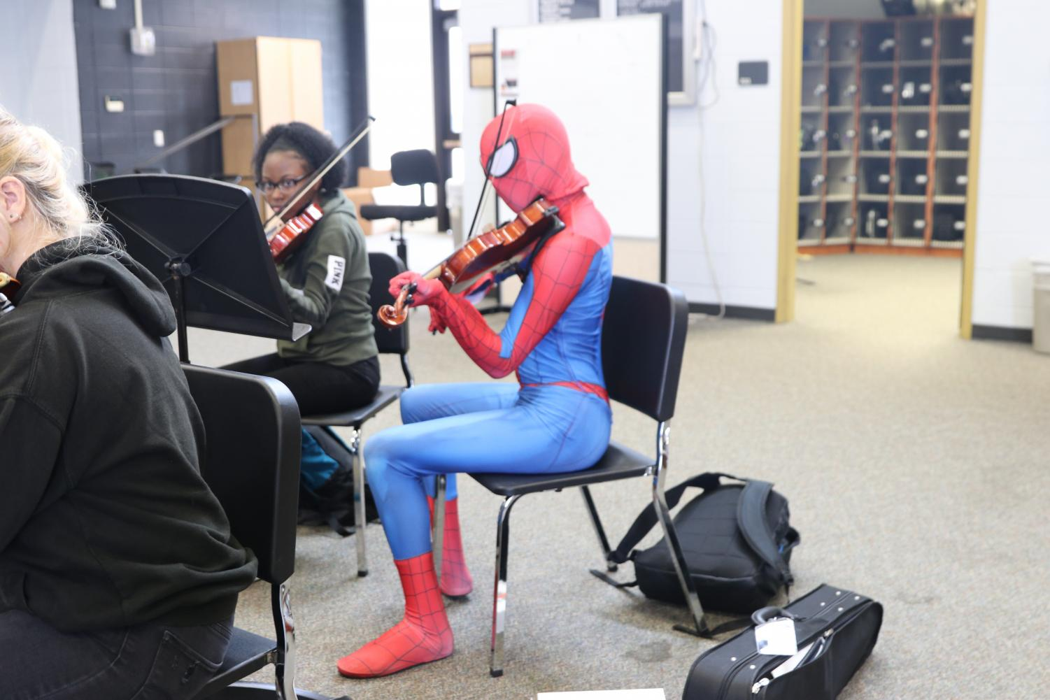 Senior Bryce Allen doesn't skip a beat while dressed up as Spider-Man during his 4th period Symphony Orchestra class on Meme Day.
