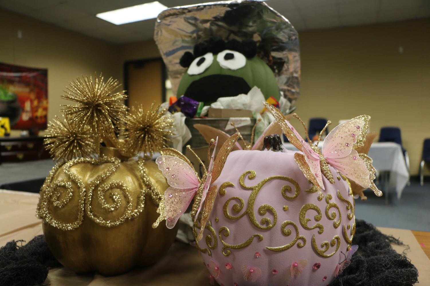 Oscar the Grouch by Brianna Trask peaks out from behind two beautiful entries.