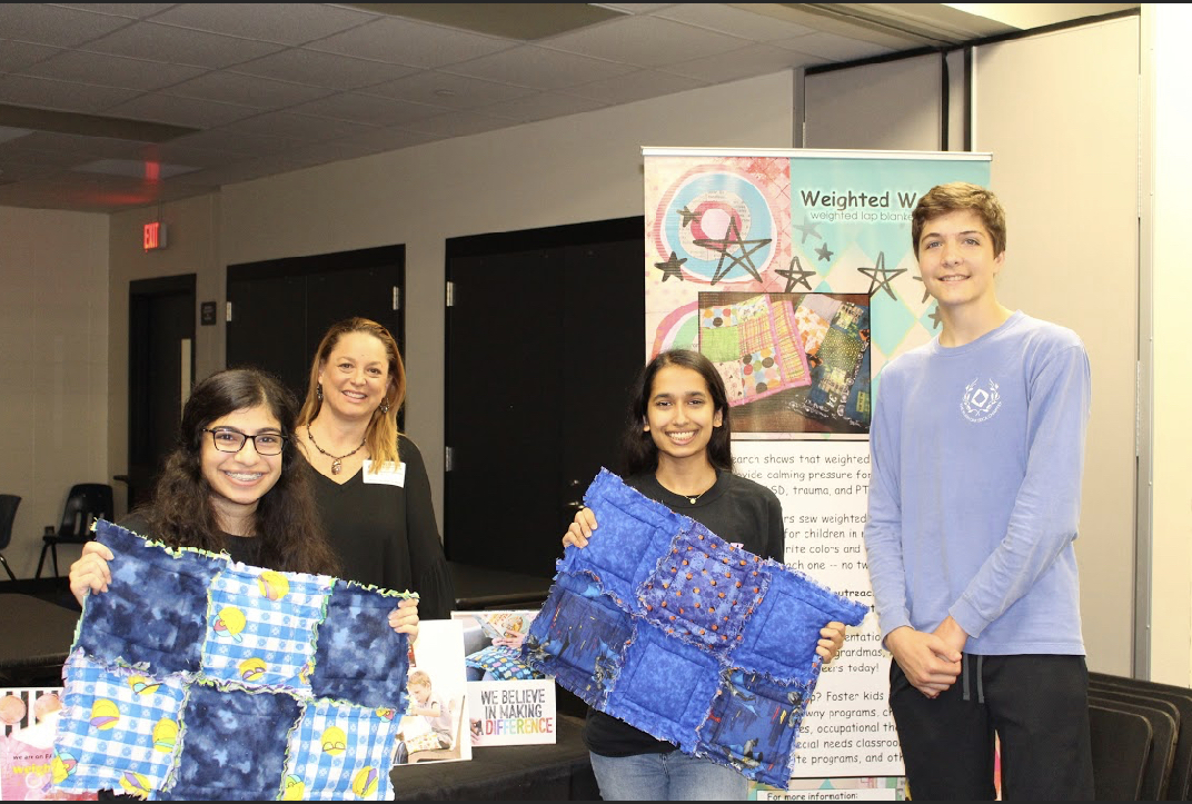 Attending the informational meeting for the Weighted Wonders Communitry Giving Campaign, junior Aleena Ajani, founder of Weighted Wonders Johny Mahler, junior Sarah Lalani, and junior Will Ash plan to lead this project for the local chapter.