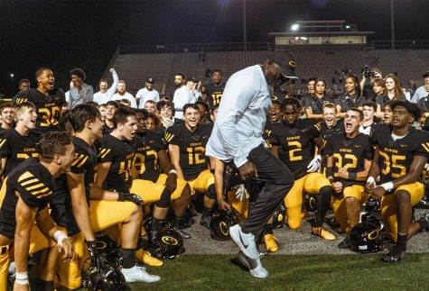 Coach Glenn hypes his players up after a huge win against the 17th team in the state. Oak took home an impressive 21-10 victory over the Woodlands last week.
