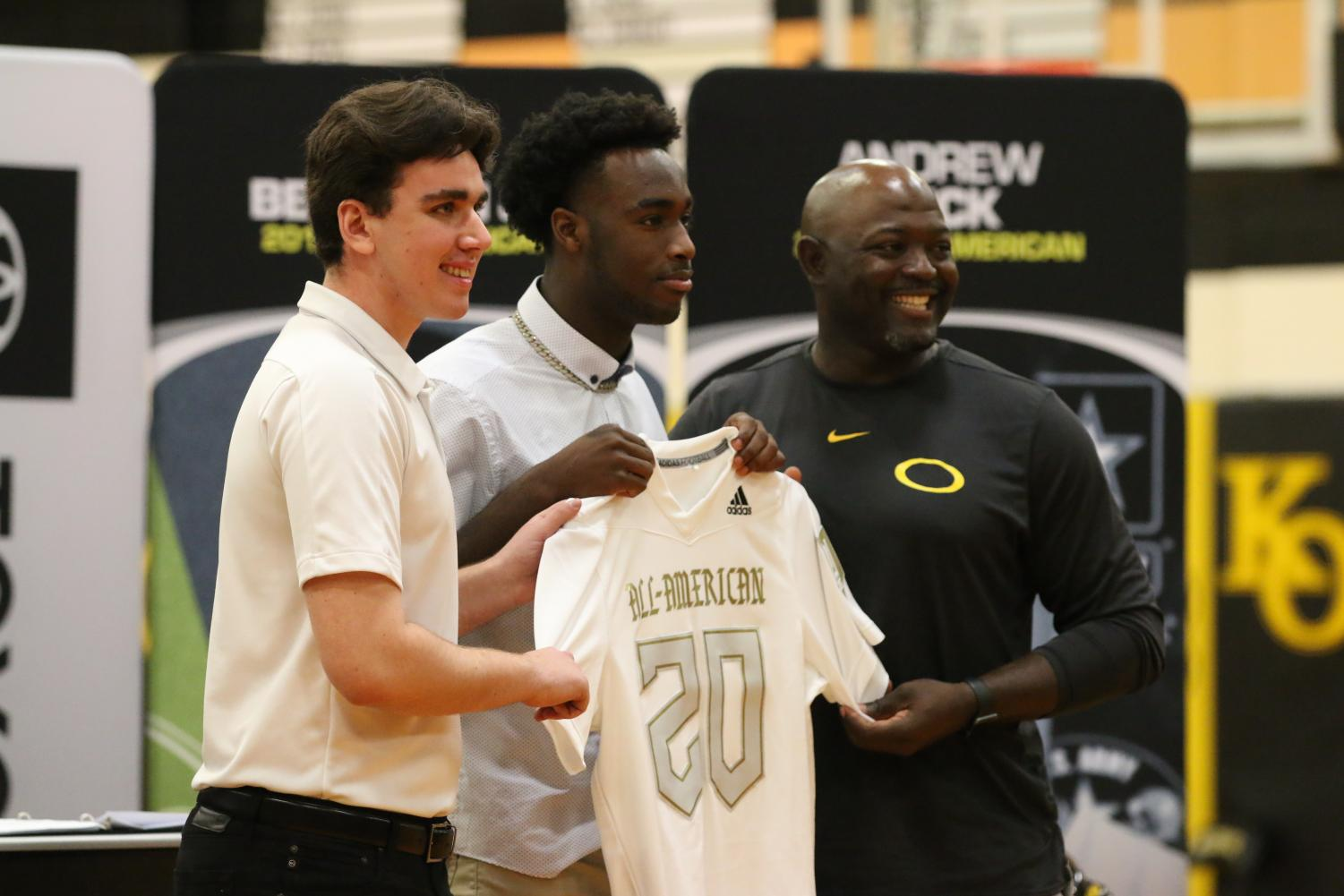 Along with the bowl game representative, senior Dwight McGlothern and Athletic Director and Head Coach Jason Glenn present #20 his jersey for the U.S. Army All-American Bowl game. McGlothern was greeted in pep rally fashion by other athletes to celebrate his selection.