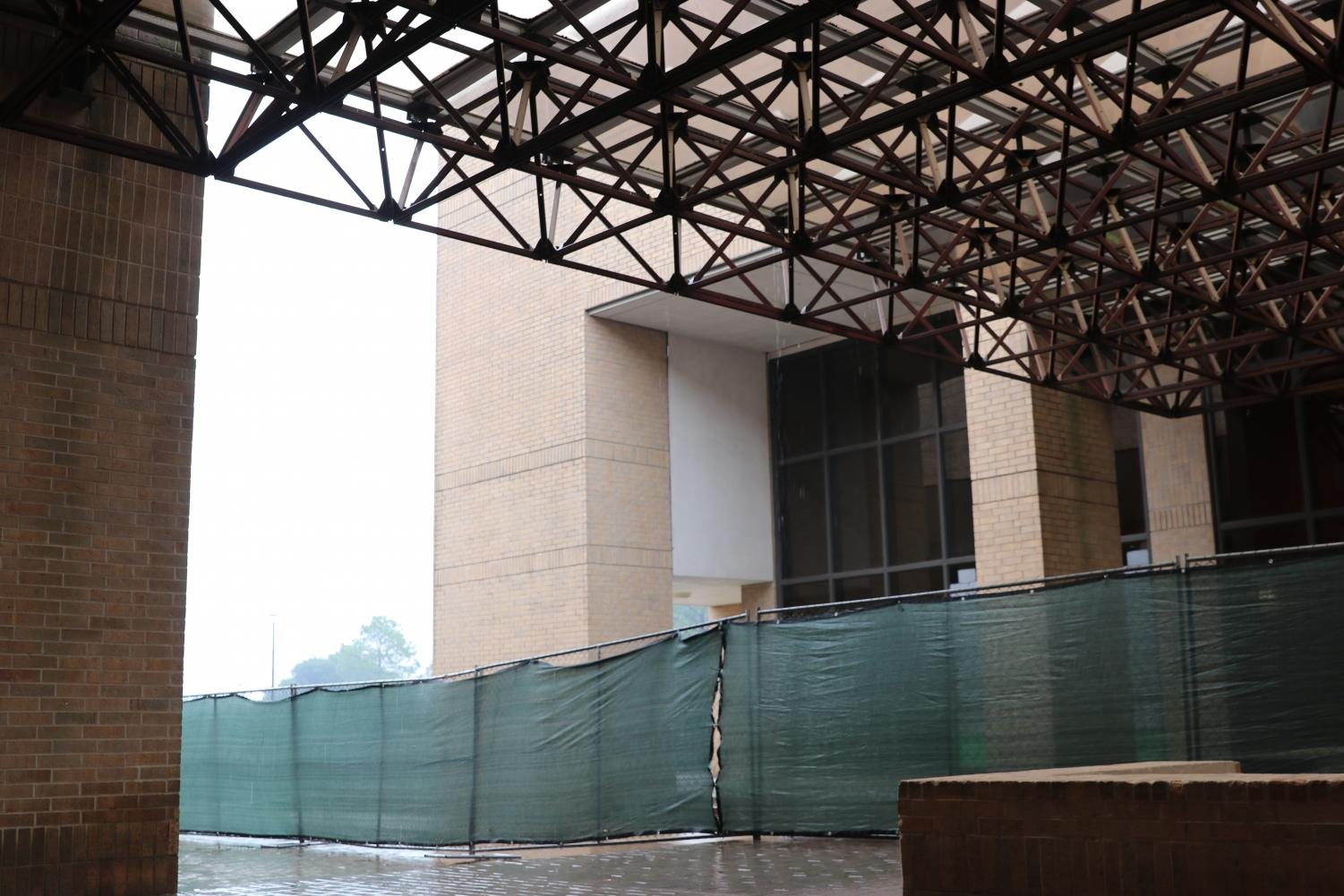 Students are getting used to the green fences around the school as long awaited renovation construction begins on the theater and an additional wing will be built behind the small gym.
