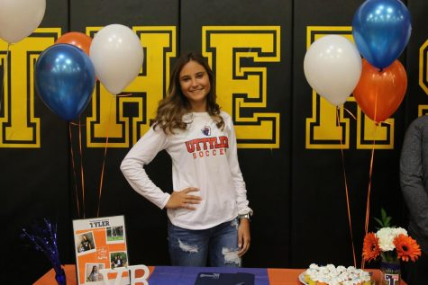 Vanessa Bart beams with happiness after signing her official commitment to UT Tyler to play girls soccer.