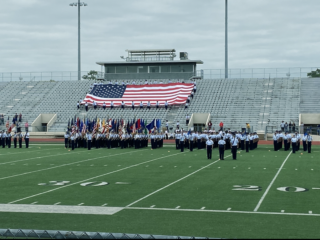 All of the Klein ISD high school squadrons stand in formation at attention ready to proudly honor the attending veterans after weeks of preparation for the ceremony.