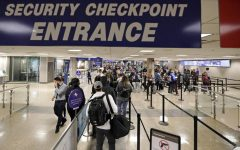 Entrance to the security checkpoint where airport officers make sure all passengers are not threats to others while traveling.