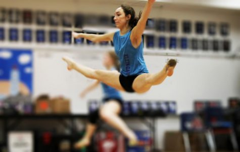 During her Strutter class period, freshman Meredith Carrasco practices her turning center leap. This advanced leap is a part of the team jazz choreography.