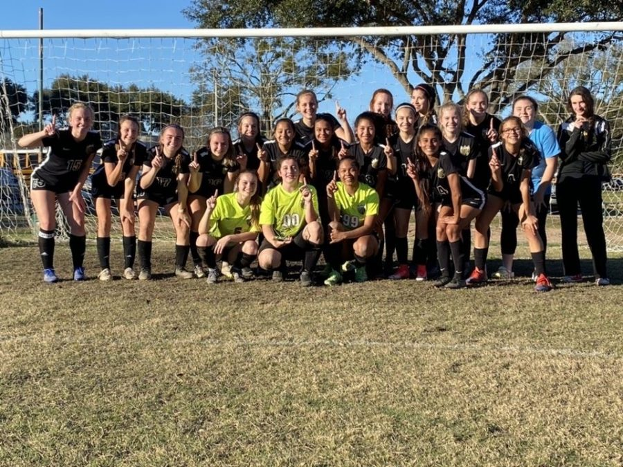 Celebrating their first place win at the Waller Varsity Classic, Klein Oak Junior Varsity members gather for a team picture.