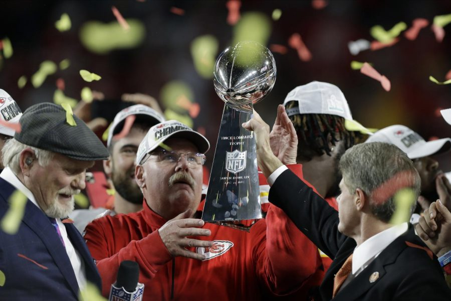 Kansas+City+Chiefs+Head+Coach+Andy+Reid+holds+the+Superbowl+54+trophy.+This+is+Reid%27s+first+Superbowl+win+in+his+20+years+as+an+NFL+head+coach.