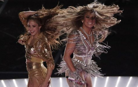 Zealous performers Shakira and J.Lo strike a pose during their Feb 2 Super Bowl halftime performance. The artists' exuberant dancing and skimpy costuming caused an uproar from viewers.