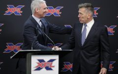 XFL Commissioner Oliver Luck and Seattle Dragons Head Coach Jim Zorn meet to discuss Zorn's introduction into the league. Before the pandemic, football fans flocked to games of the new league, enticed by cheap ticket prices and non-stop action on the field.