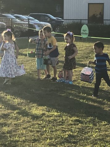 Preparing a strategic attack on the Easter candy, children at the Real Life Church line up for the Easter tradition last year. This year's celebrations will be held differently due to COVID-19, but parents say the bunny is still heading to town.