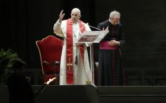Pope Francis is flanked by Mons. Guido Marini as he delivers his blessing during the Via Crucis – or Way of the Cross – ceremony in front of St. Peter's Basilica, empty of the faithful following Italy's ban on gatherings during a national lockdown to contain contagion, at the Vatican, Friday, April 10. In Spring and Tomball, following the guidelines set forth by Governor Greg Abbott and by recommendations of local officials, churches are planning to hold all Good Friday and Easter services online to keep their parishioners safe from COVID-19.