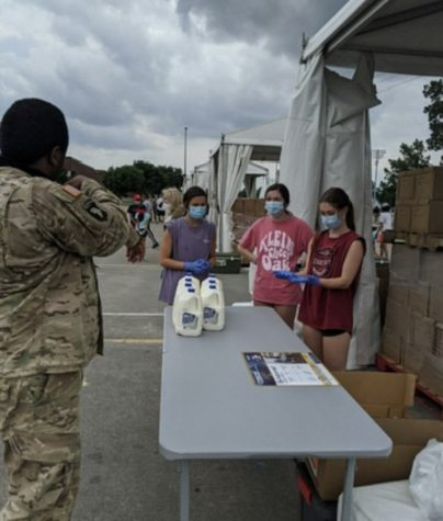 Seniors Aubrey Desantis (left), Emma Osborne (center), and Clare Bearden (right) volunteering for NHS. They worked food distribution tables for  the Houston Food Bank and wore masks as a coronavirus precaution.