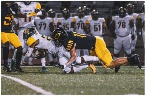 Junior Gannon Tullos tackles the Golden Eagle running back for a small loss, the Panthers defense was electric and only allowed one score from Klein Forest.