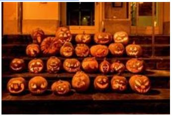 Carved pumpkins sit out on the porch anticipating trick or treaters to be spooked while they gather all the sweets they can carry.