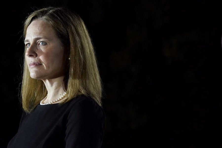 """Amy Coney Barrett stands ready to be inducted as the newest Supreme Court Justice. Students have many hopes for her time on the court. One wish is that she remain neutral in her rulings. """"I think a Supreme Court Justice should not lean any specific way and should not be biased toward either party,"""" senior Cooper Anders said."""
