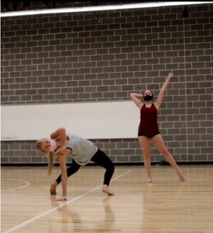 Junior lieutenant Landry Albright and rookie Kylie Stuart are practicing their pom contest routine in the new Strutter studio. The wood flooring allows the dancers to perform to their full potential during practice. The lines also help the dancers stay in formation throughout routines.