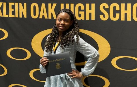Graduating 20th in the Class of 2021, sophomore/senior PJ Miller poses with her honors at the Klein Oak Top 10% Ceremony.
