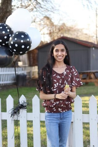 As graduation nears, valedictorian Sarah Lalani prepares to set off confetti for a photo shoot. Lalani plans to pursue a career in medicine.