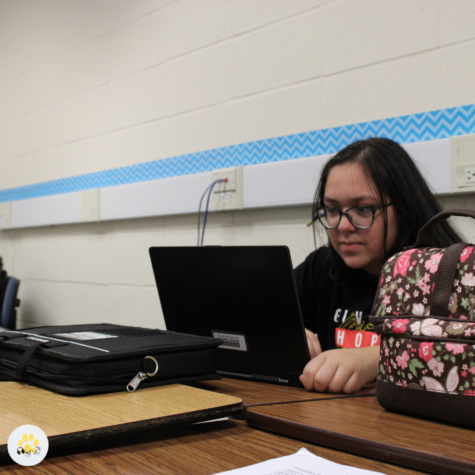 Hard at work, sophomore Gwyneth Gonzalez gets used to student life on campus.