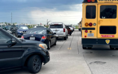 """Lines of buses and cars wait to get out of the south lot right after school. """"There was an incident a couple days ago where a car pulled into the exit during peak traffic time after school...another car pulled in behind… causing one of the lanes to be stopped up,"""" Cole said."""