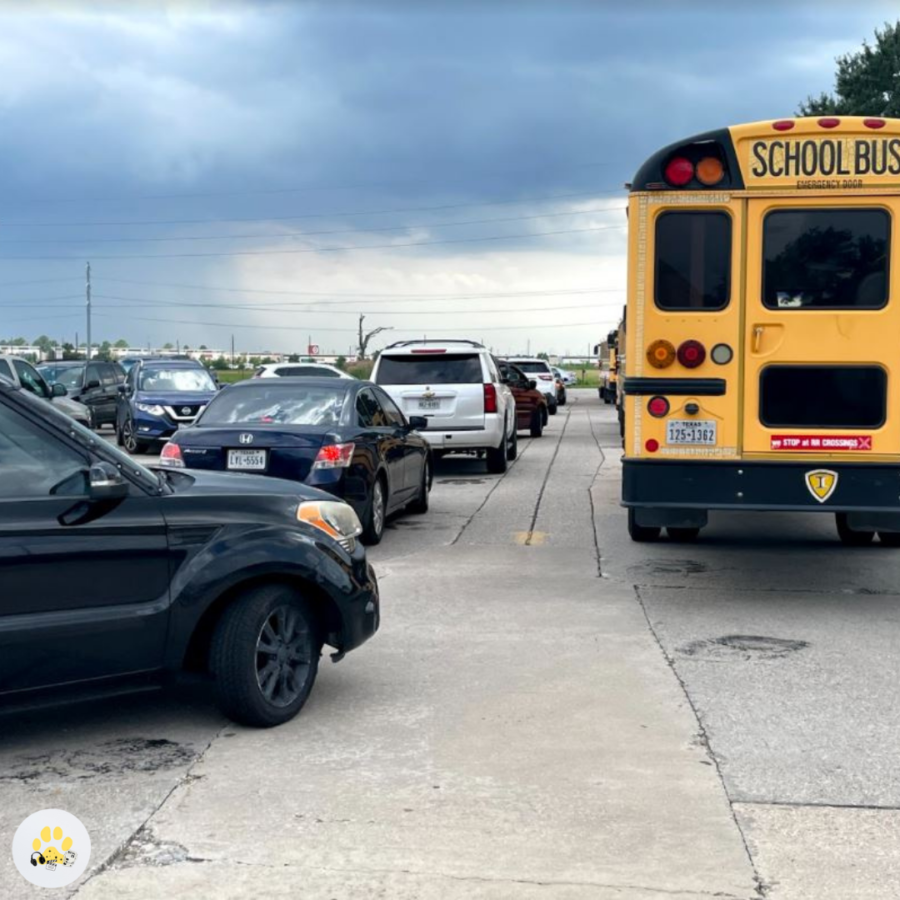 Lines+of+buses+and+cars+wait+to+get+out+of+the+south+lot+right+after+school.+%E2%80%9CThere+was+an+incident+a+couple+days+ago+where+a+car+pulled+into+the+exit+during+peak+traffic+time+after+school...another+car+pulled+in+behind%E2%80%A6+causing+one+of+the+lanes+to+be+stopped+up%2C%E2%80%9D+Cole+said.+