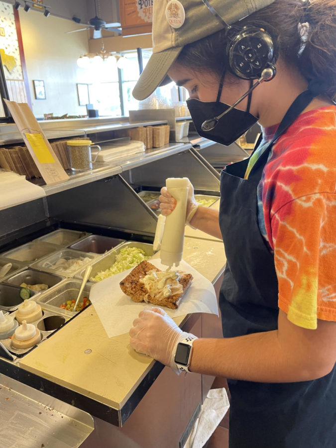 Melissa Borges makes a sandwich for a customer at Potbelly while working her summer job.